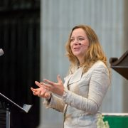 Dr Paula Gooder talks in a church.