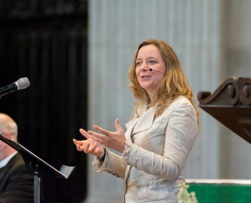 Dr Paula Gooder talks in a church.