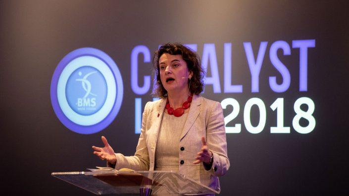 Baroness Elizabeth Berridge speaking in front of the Catalyst Live logo