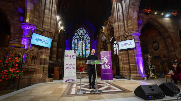 Mark Woods speaking in the dramatic nave of the Birmingham church